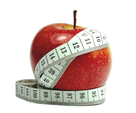 Red apple with measuring tape Stock Photo - 15023224