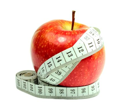 Red apple with measuring tape Stock Photo