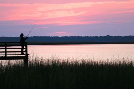 Fisherman at lake Lebsko, Poland Stock Photo