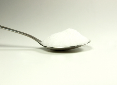 Spoon with salt photo