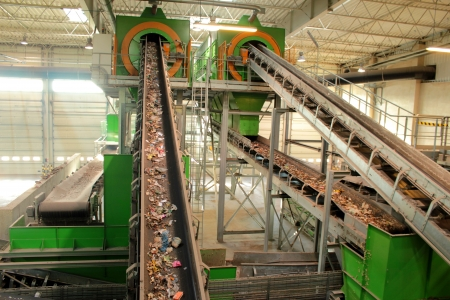 discarded metal: Recycling center with conveyer belt