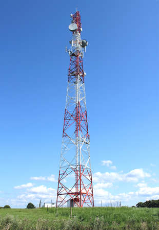 Communication tower over blue sky