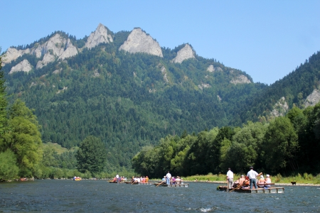 challange: Dunajec River in Pieniny Mountains with Three Crowns Mount background, Poland Editorial