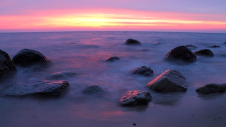 Stones in the sea at the sunset, Gdynia, Poland