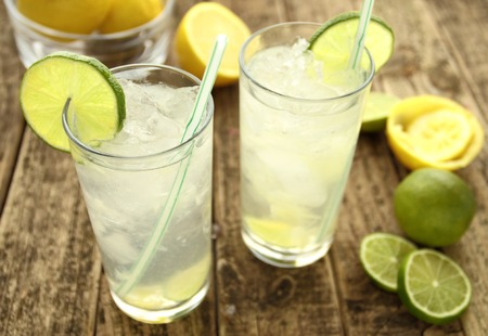 Cold lemon drinks with lime and ice