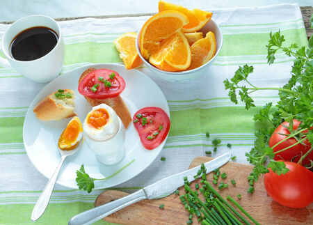 Breakfast with boiled egg and healthy vegetables Stock Photo