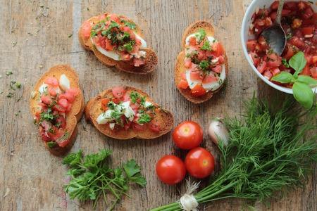 Tasty bruschettas with fresh tomato, garlic, fennel and mozzarella