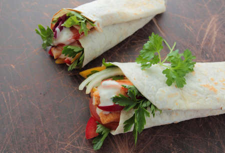 Tortilla wraps with fresh chicken, vegetables and garlic sauce photo