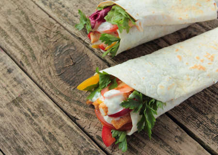 Tortilla wraps with fresh chicken and vegetables photo