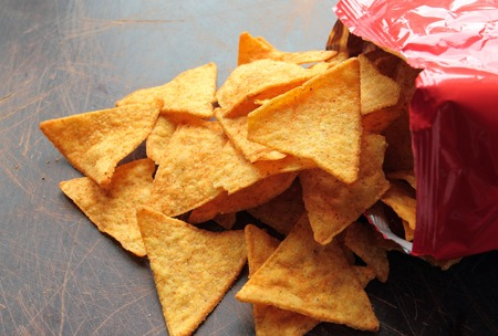 chips and salsa: Spicy nachos chips on a wooden table
