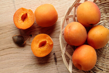 Fresh apricot friuts on a wooden desk