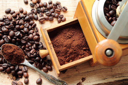 Fresh milled coffee with old vintage grinder