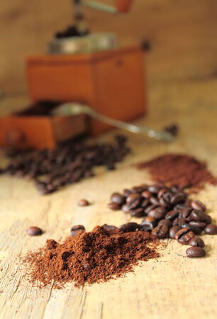 Milled coffee powder with fresh roasted beans photo