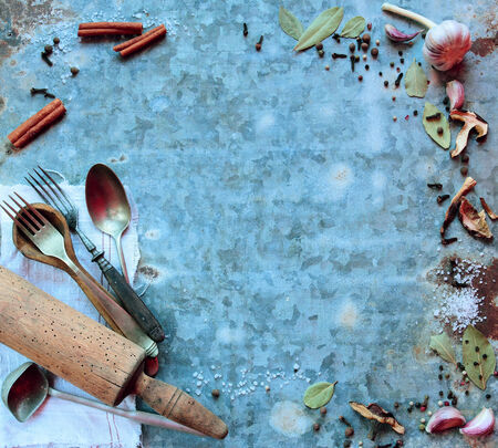 Old kitchen cutlery and utensils with various spices photo