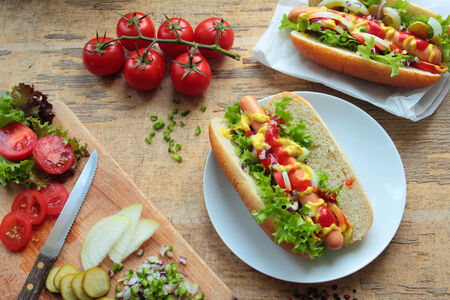 large dog: Two homemade hotdogs with sausages and fresh vegetables Stock Photo