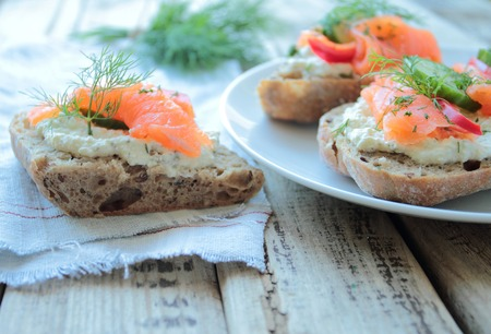 Bread with salmon on a plate photo