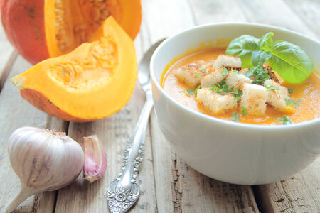 Bowl with pumpkin soup with crunchy croutons