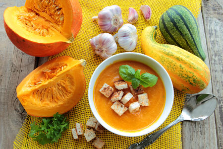 Pumpkin soup with herbs and croutons