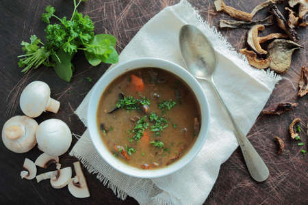 mushroom soup: Bowl with mushroom soup with fresh parsley