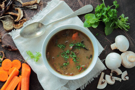 mushroom soup: Bowl with hot mushroom soup with carrot and parsley