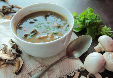 Mushroom soup with fresh champignons and parsley photo