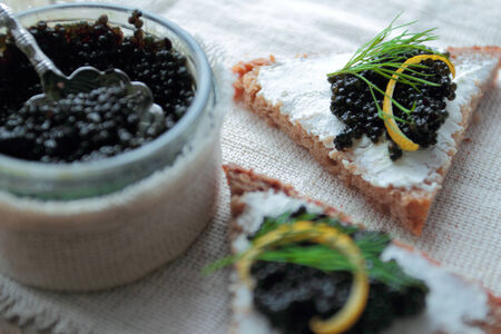 Black caviar with dill on dark bread for appetizer