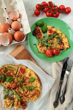 smithereens: Omelet with tomatoes and fresh rucola leafs for breakfast