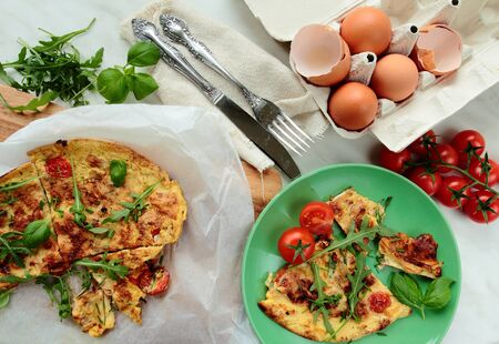 smithereens: Fresh omelet with rucola leafs and tomatoes for breakfast