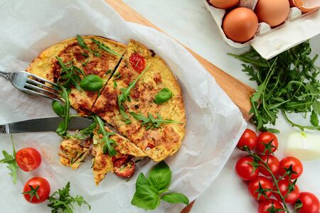 smithereens: Omelet with fresh salad leafs and tomatoes