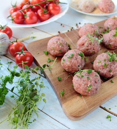 Raw meat balls with fresh herbs Stock Photo