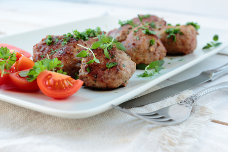 Plate with meatballs with fresh parsley and thyme twigs Stock Photo
