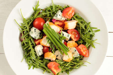 mildew: Fresh rucola, tomato, chive and mildew cheese with chicken Stock Photo