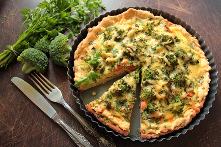 Casserole pie with vegetable, broccoli, cheese and fresh parsley