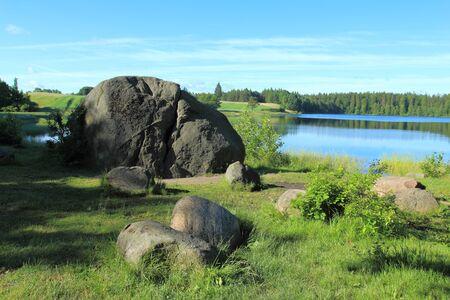 lobelia: Erratic boulders at the Kamienne Lake in Kashubian Region, Poland