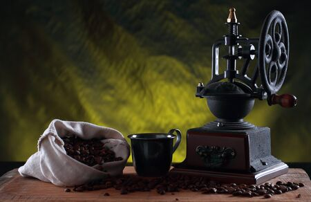 Coffee grinder with bag of coffee beans
