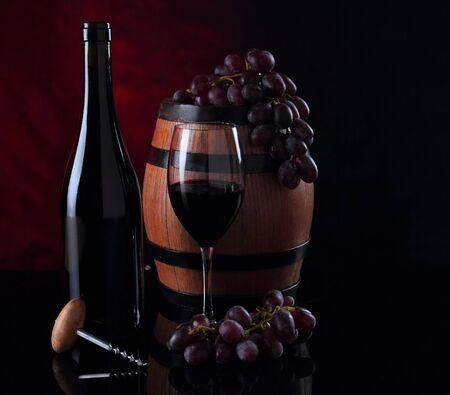 Bottle with red vine. Barrel, bottle and vineglass