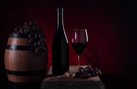 Bottle with sweet red vine. Old barrel with vine Stock Photo
