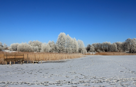 Frozen lake in winter, Masurien region, Poland