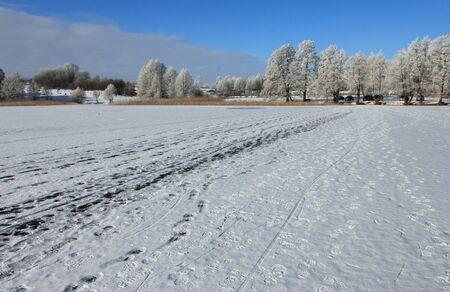 Fishermans traces on forzen lake, Masurien region, Poland