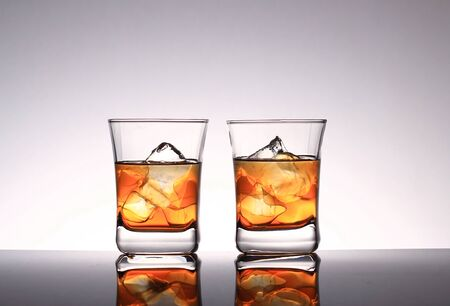 Glasses with whiskey and ice