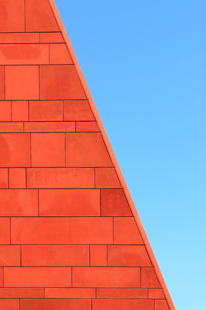 Architecture abstract. Red brick wall over blue sky