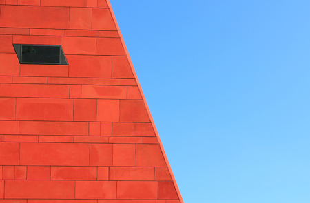 Architecture abstract. Red wall over blue sky Editorial