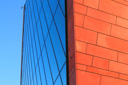 Glass and brick wall over blue sky Stock Photo