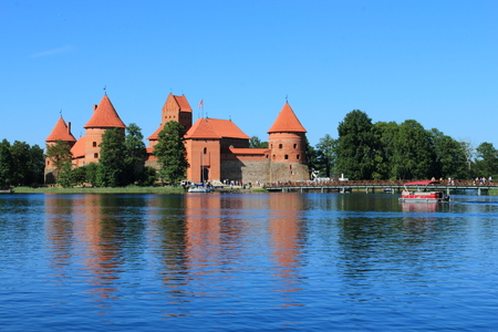Medieval gothic Trakai Island Castle with stone walls and towers with red tiled roofs in Lake Galve, Lithuania Stock Photo