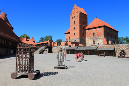 Trakai Island Castle with stone walls and towers with red tiled roofs in Lake Galve, Lithuania Editorial
