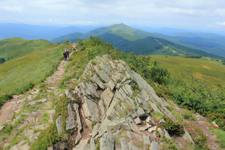 Polonina Welinska. Tourist on trekking path near mountain shelter Puchatek Hut (Chatka Puchatka), Bieszczady Mountains, Poland Stock Photo