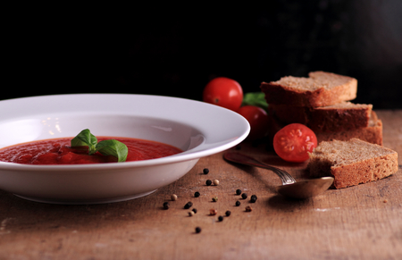 Tomato cream soup with fresh basil