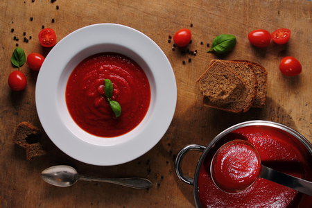 Tasty traditional tomato soup in white plate