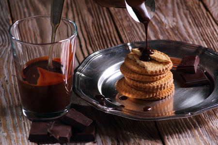 Sweets and desserts, chocolate and biscuits on wooden rustic background