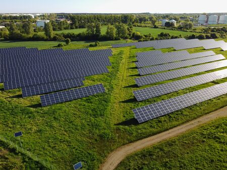 Aerial view on photovoltaic power plant, solar panels